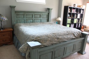 Bed with blue base and dark stain.