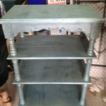 Small shelves with blue base and metallic green glaze
