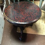 Distressed black with red stencil and high gloss.
