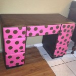 Brown desk with pink & polka dot drawers.