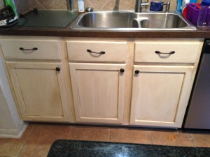 White cabinets with dark glaze